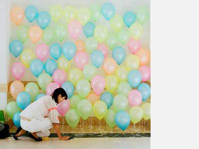 Multicolored balloon wall backdrop (Source: popsugar.com)