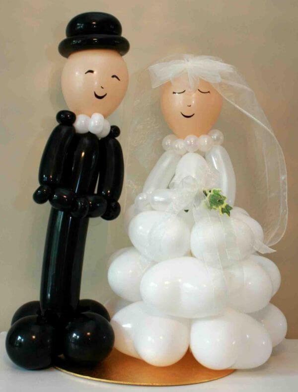 Bride and groom balloon sculptures as table top decor.