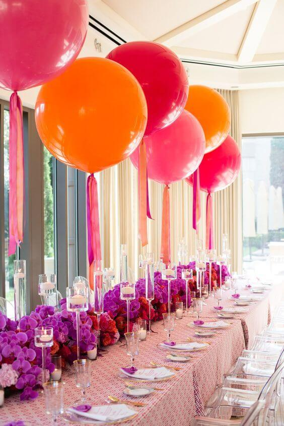 Large round balloons in pink and orange