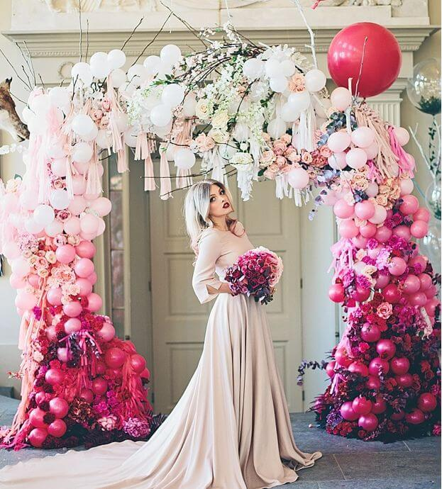 Organic balloon arch with bride