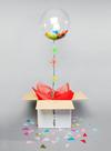 Confetti / tissue stuffed balloon in a box