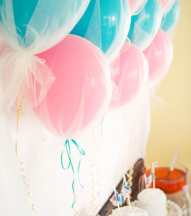 tulle covered balloons in pink and powder blue