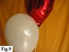 Adjusting height of latex and mylar balloons.