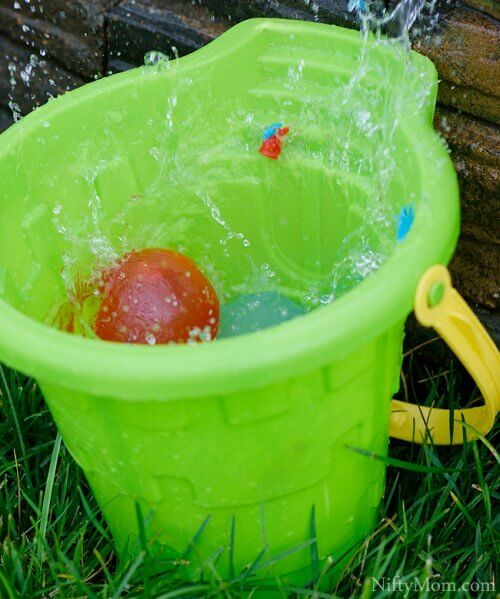 Plastic bucket with water balloons