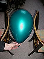 Measure the balloon size between the back of two chairs.