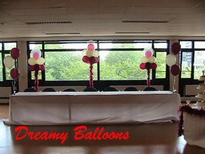 Cloud 9 balloons of variable height in Burgundy and Ivory with dotted 18