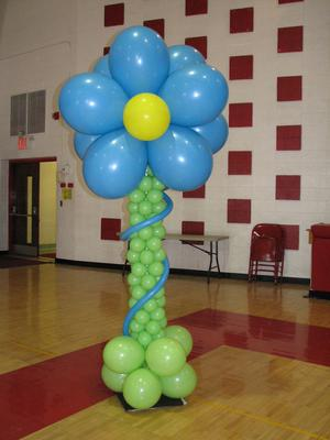 Balloon Column with Flower Topper (Image Credit: www.exclusiveballoons.com)