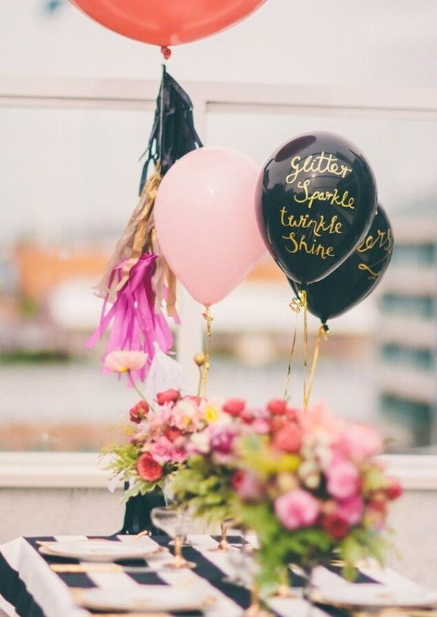 black latex balloons with gold hand writing